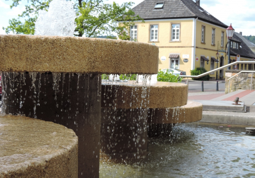 fountain in front of the town hall - next to the clock museum